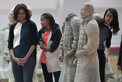 Can I hold the little clay one? Malia and Sasha will get a Girl Scout merit badge.