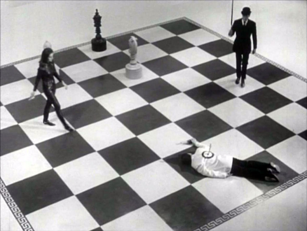 You know. A great big chess board with black and cats enacting the game.