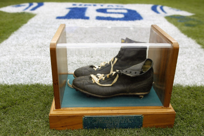 BALTIMORE - SEPTEMBER  15:  Detail of an onfield tribute to Hall of Fame quarterback Johnny Unitas #19 of the Baltimore Colts with his signature black high tops in a glass case during halftime of the NFL game between the Tampa Bay Buccaneers and the Baltimore Ravens on September 15, 2002 at Ravens Stadium in Baltimore, Maryland. The Buccaneers shut out the Ravens 25-0.  (Photo By Scott Halleran/Getty Images)